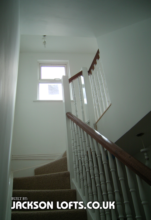 Window giving lots of natural light on stair case built by Jackson Lofts, Brighton